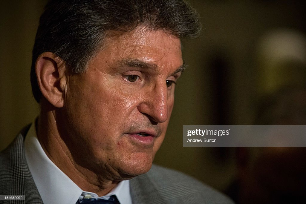 Sen. <a gi-track='captionPersonalityLinkClicked' href=/galleries/search?phrase=Joe+Manchin&family=editorial&specificpeople=568465 ng-click='$event.stopPropagation()'>Joe Manchin</a> III (D-WV) talks to members of the media at the Capitol Building on October 14, 2013 in Washington, DC. As Democratic and Republican leaders negotiate an end to the shutdown and a way to raise the debt limit, the White House postponed a planned Monday afternoon meeting with Boehner and other Congressional leaders. The government shutdown is currently in its 14th day.