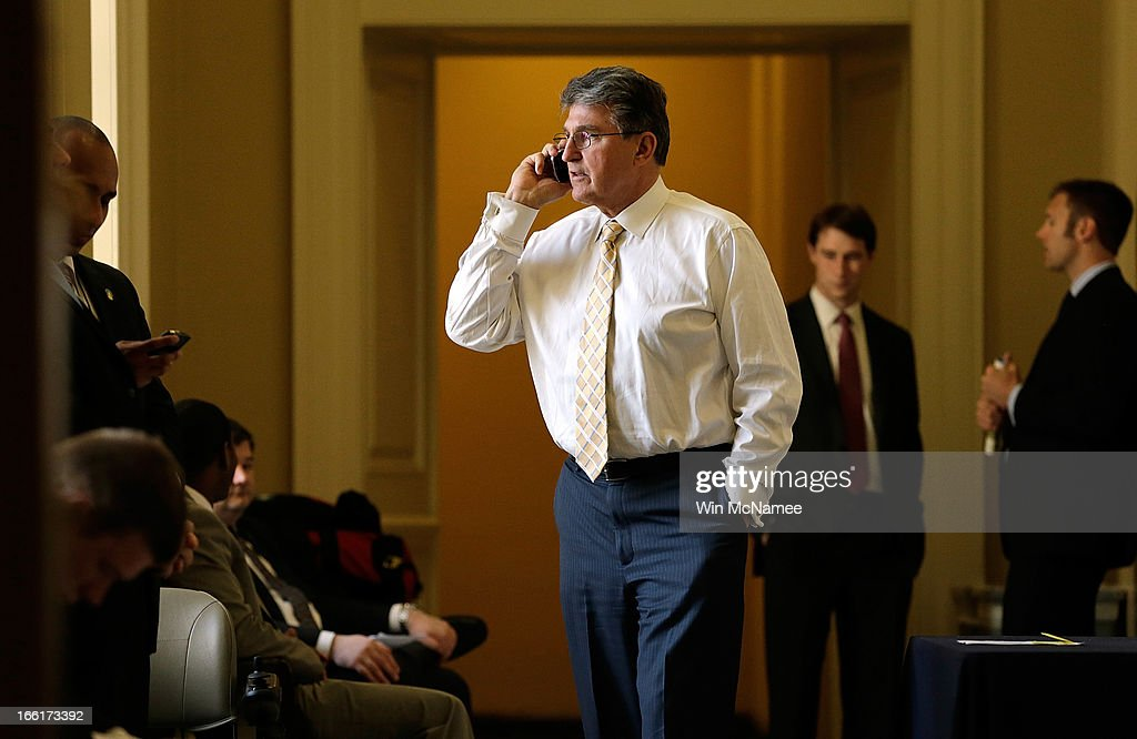 Sen. <a gi-track='captionPersonalityLinkClicked' href=/galleries/search?phrase=Joe+Manchin&family=editorial&specificpeople=568465 ng-click='$event.stopPropagation()'>Joe Manchin</a> (D-WV) speaks on the phone outside the weekly Democratic policy luncheon April 9, 2013 in Washington, DC. Manchin is a key player in an effort to reach a compromise on gun control legislation by expanding background checks.