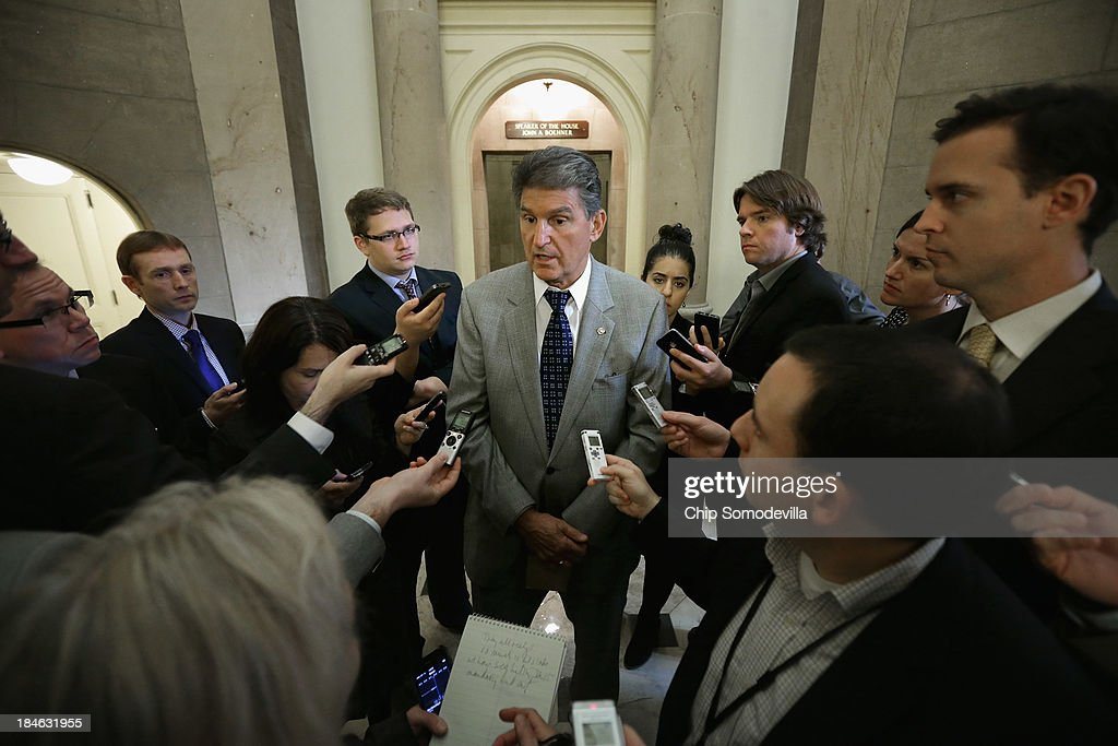 Sen. <a gi-track='captionPersonalityLinkClicked' href=/galleries/search?phrase=Joe+Manchin&family=editorial&specificpeople=568465 ng-click='$event.stopPropagation()'>Joe Manchin</a> (D-WV) (C) talks with reporters at the U.S. Capitol October 14, 2013 in Washington, DC. President Barack Obama postponed a meeting with Congressional leaders after the possiblity of a legislative solution to the partial federal government shutdown and the looming debt ceiling.
