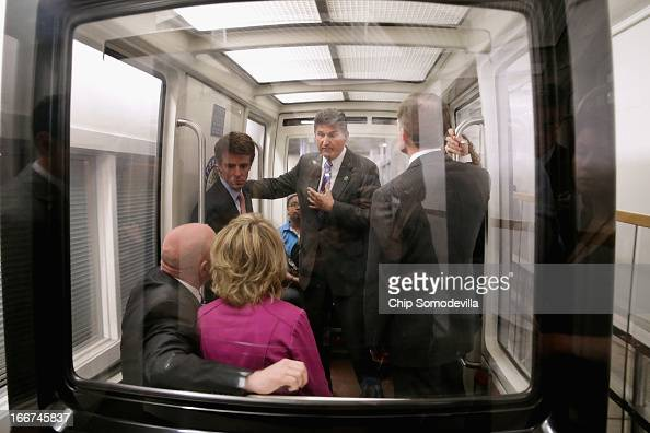 Sen Joe Manchin talks with shooting victim and former Rep Gabrielle Giffords and her husband and retired astronaut Mark Kelly while riding the subway...