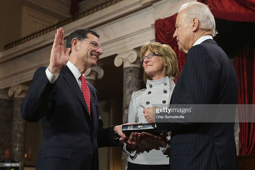 U.S. Sen. John Barrasso (R-WY) (L) participates in a reenacted swearing-in with his wife Bobbi Brown and U.S. Vice President Joe Biden in the Old Senate Chamber at the U.S. Capitol January 3, 2013 in Washington, DC. Biden swore in the newly-elected and re-elected senators earlier in the day on the floor of the current Senate chamber.