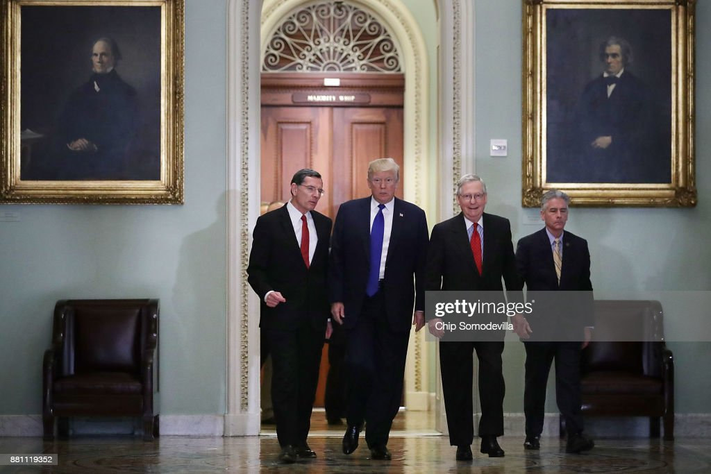 Sen. John Barrasso (R-WY), President Donald Trump, Senate Majority Leader Mitch McConnell (R-KY) and Senate Sergeant at Arms Frank Larkin head for the weekly Senate Republican Policy Committee luncheon in the U.S. Capitol November 28, 2017 in Washington, DC. Republicans in the Senate hope to pass their tax cut legislation this week and work with the House of Representatives to get a bill to Trump before Christmas.