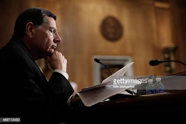 Sen John Barrasso reviews papers while senators make their opening remarks during a Senate Foreign Relations Committee markup meeting on the proposed...