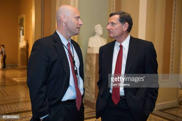 Sen John Barrasso RWyo right and White House aide Marc Short talk in the Capitol on July 27 2017