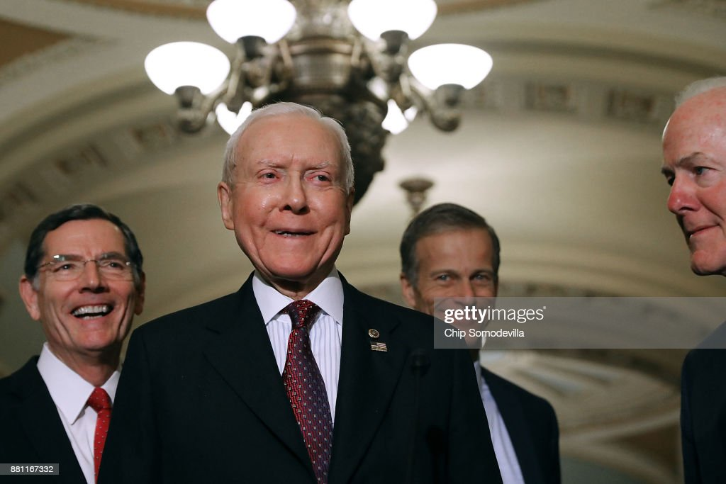 Sen. John Barrasso (R-WY), Senate Finance Committee Chairman Orrin Hatch (R-UT), Sen. John Thune (R-SD) and Senate Majority Whip John Cornyn (R-TX) talk with reporters following the weekly Senate Republican Policy Committee luncheon in the U.S. Capitol November 28, 2017 in Washington, DC. Republicans in the Senate hope to pass their tax cut legislation this week and work with the House of Representatives to get a bill to President Donald Trump before Christmas.