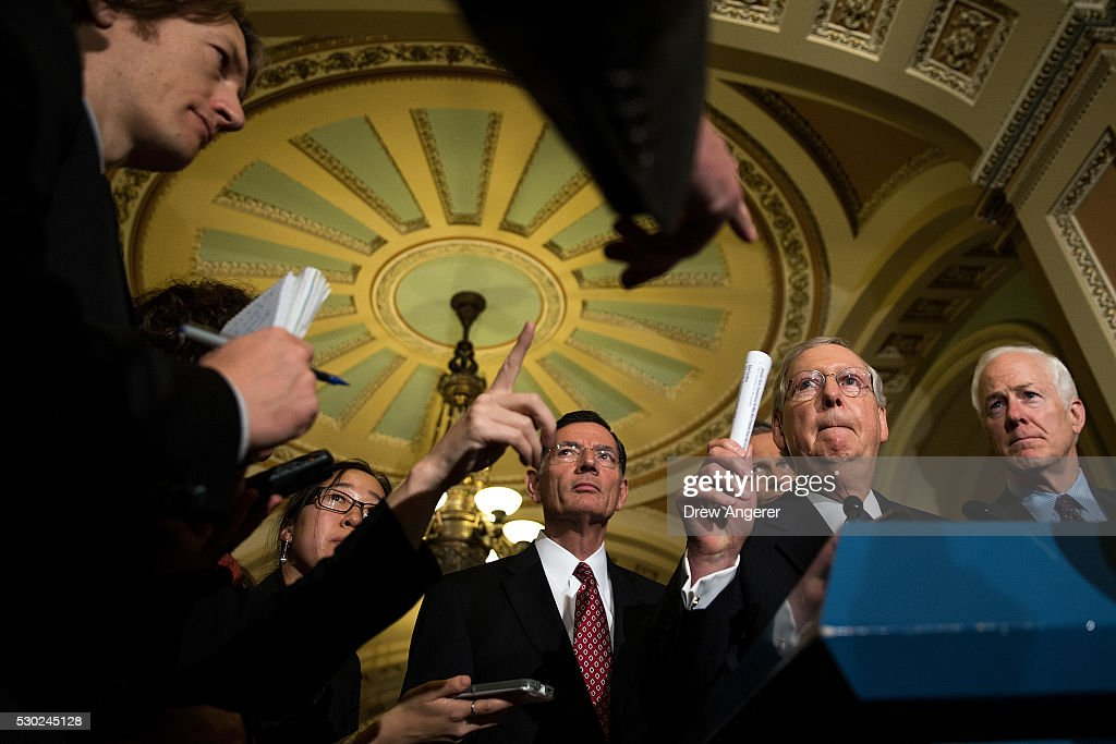 , Sen. <a gi-track='captionPersonalityLinkClicked' href=/galleries/search?phrase=John+Barrasso&family=editorial&specificpeople=5312607 ng-click='$event.stopPropagation()'>John Barrasso</a> (R-WY), Senate Majority Leader Mitch McConnell (R-KY) and Sen. <a gi-track='captionPersonalityLinkClicked' href=/galleries/search?phrase=John+Cornyn&family=editorial&specificpeople=154884 ng-click='$event.stopPropagation()'>John Cornyn</a> (R-TX) listen to questions from reporters during news conference after their weekly policy meeting with Senate Republicans, at the U.S. Capitol, May 10, 2016, in Washington, DC. Presidential candidate Donald Trump is scheduled meet with Republican House and Senate leadership on Thursday.