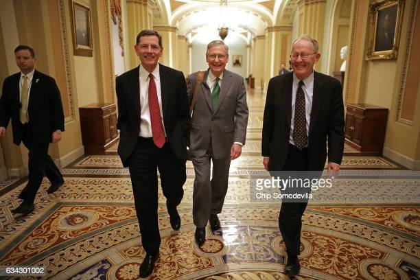 Sen John Barrasso Senate Majority Leader Mitch McConnell and Sen Lamar Alexander walk thorugh the US Captiol after the Senate confirmed Sen Jeff...