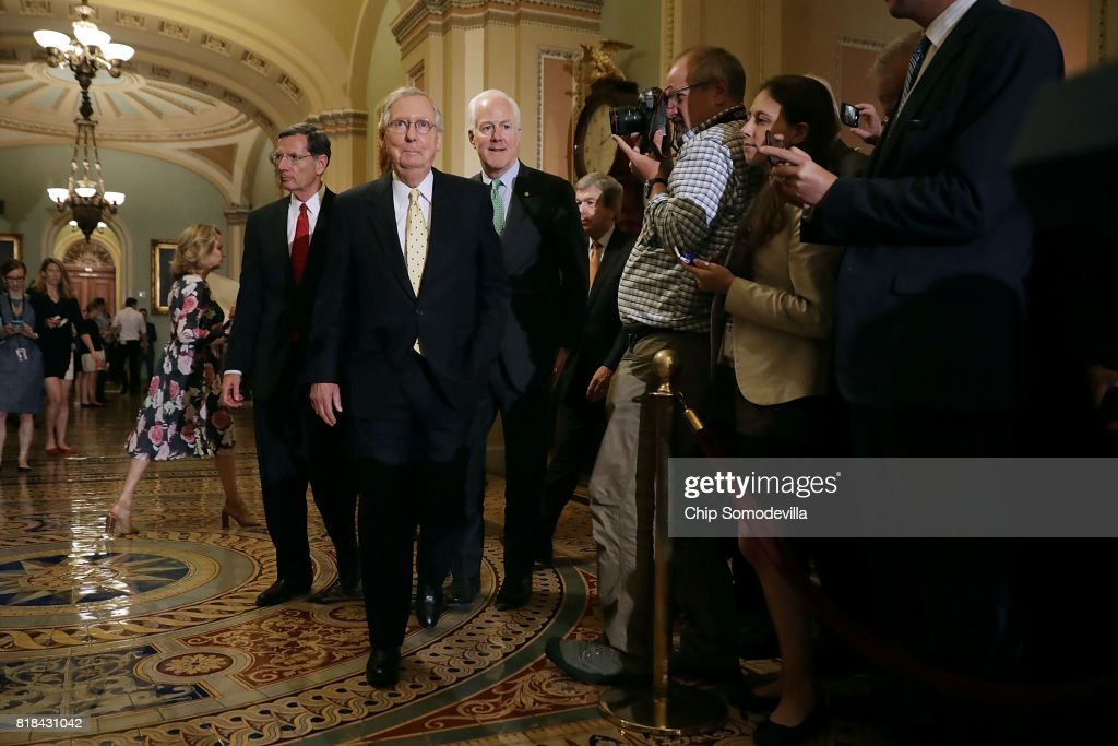 Sen. John Barrasso (R-WY), Senate Majority Leader Mitch McConnell (R-KY) and Senate Majority Whip John Cornyn (R-TX) prepare to speak to reporters following the weekly Senate Republican policy luncheon at the U.S. Capitol July 18, 2017 in Washington, DC. McConnell said there are not enough votes for his plan to repeal and replace the Affordable Care Act but he plans on introducing legislation that would simply repeal Obamacare.