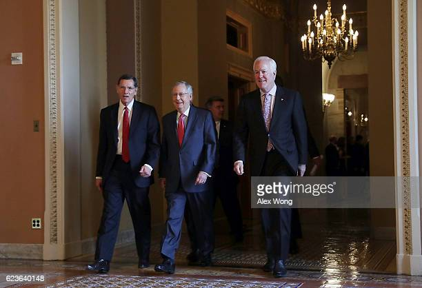 US Sen John Barrasso Senate Majority Leader Sen Mitch McConnell and Senate Majority Whip John Cornyn leave after an election meeting of Senate...