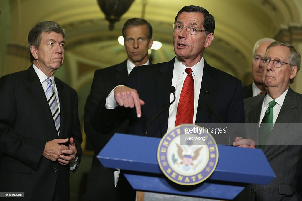 U.S. Sen. John Barrasso (R-WY) speaks to members of the media as (L-R) Sen. Roy Blunt (R-MO), Sen. John Thune (R-SD), Senate Minority Whip Sen. John Cornyn (R-TX) and Senate Minority Leader Sen. Mitch McConnell (R-KY) listen after the weekly Senate Republican Policy Committee luncheon July 8, 2014 on Capitol Hill in Washington, DC. Senate GOPs gathered at the luncheon to discuss the Republican agenda.