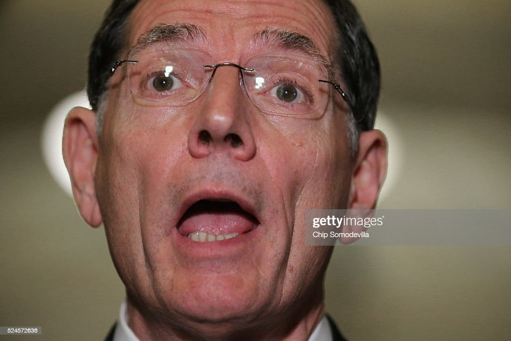 Sen. <a gi-track='captionPersonalityLinkClicked' href=/galleries/search?phrase=John+Barrasso&family=editorial&specificpeople=5312607 ng-click='$event.stopPropagation()'>John Barrasso</a> (R-WY) talks with reporters following the weekly Republican Senate policy luncheon at the U.S. Capitol April 26, 2016 in Washington, DC. Republicans and Democrats in the Senate are at odds about how much money the federal government should spend on preparation and prevention of the spread of the Zika virus once it arrives in the United States this summer.