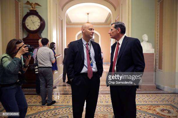 Sen John Barrasso talks with White House Director for Legislative Affairs Marc Short following a Republican caucus meeting at the US Capitol July 27...