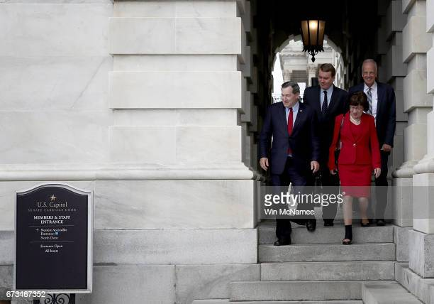 Sen John Boozman Sen Joe Donnelly Sen Susan Collins and Sen Jerry Moran depart the US Capitol for a briefing on North Korea at the White House April...