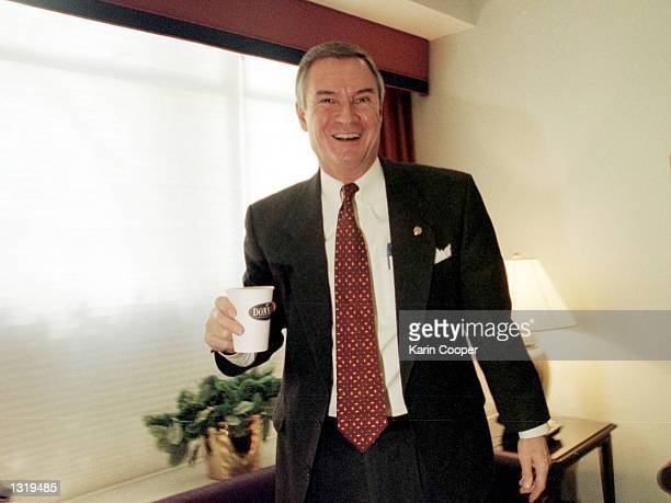 Sen John Breaux laughs in the Green Room prior to his appearance on the CBS talk show 'Face the Nation' December 3 2000 in Washington DC