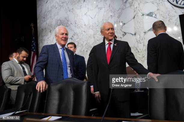 Sen John Cornyn and Sen Orrin Hatch talk with each other before the start of a Senate Judiciary Committee hearing titled 'Oversight of the Foreign...