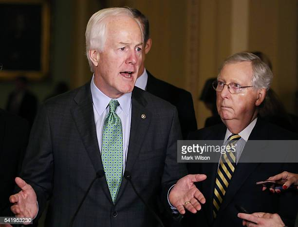 Sen John Cornyn and Senate Majority Leader Mitch McConnell speak to reporters after their weekly policy luncheon on Capitol Hill June 21 2016 in...