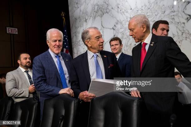 Sen John Cornyn committee chairman Sen Chuck Grassley and Sen Orrin Hatch talk with each other before the start of a Senate Judiciary Committee...