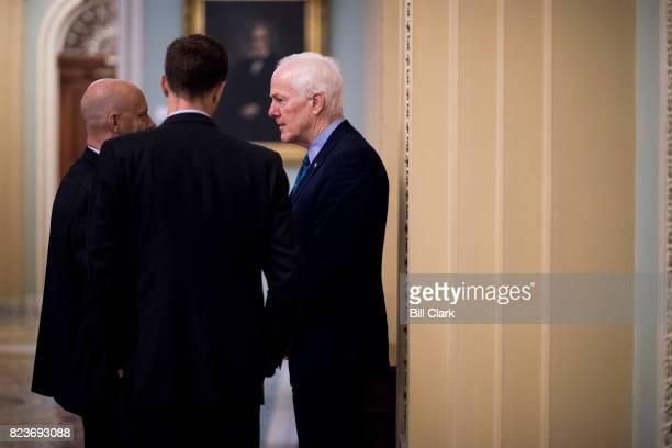 Sen John Cornyn RTexas right speaks with President Trump's director of legislative affairs Mark Short left outside of the Senate floor in the Capitol...