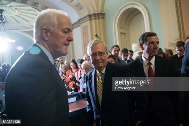 Sen John Cornyn Senate Majority Leader Mitch McConnnell and Sen John Barrasso leave the podium after speaking to reporters following a procedural...