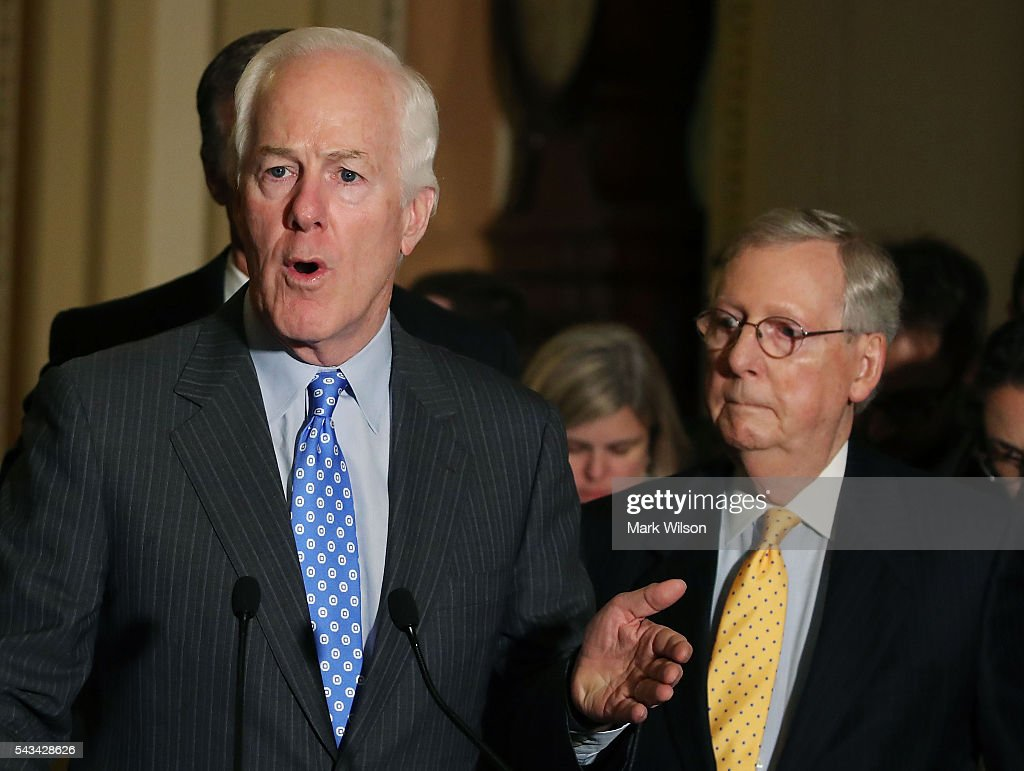 Sen. John Cornyn (R-TX), (L), speaks to reporters while flanked by Senate Majority Leader <a gi-track='captionPersonalityLinkClicked' href=/galleries/search?phrase=Mitch+McConnell&family=editorial&specificpeople=217985 ng-click='$event.stopPropagation()'>Mitch McConnell</a> (R-KY), on Capitol Hill, June 28, 2016 in Washington, DC. The Senate lawmakers addressed the press affter their weekly policy luncheons.