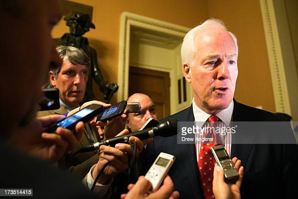 Sen John Cornyn speaks to the media after Senate joint caucus meeting on Capitol Hill July 15 2013 in Washington DC The senators met in a...
