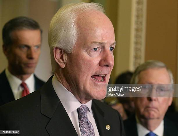 Sen John Cornyn speaks to the media while flanked by Senate Majority Leader Mitch McConnell and Sen John Thune on February 2 2016 in Washington DC...