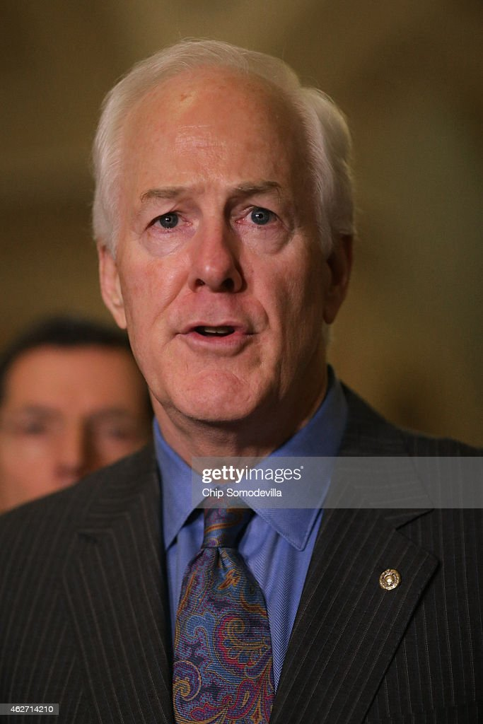Sen John Cornyn talks to reporters after the weekly Republican Senate policy luncheon at the US Capitol February 3 2015 in Washington DC Senate...