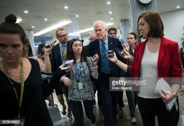 Sen John Cornyn talks to reporters as he walks through the Senate subway on his way to an amendment vote on the GOP heath care legislation on Capitol...