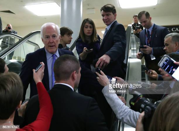 Sen John Cornyn talks to reporters on a escalator while going to the Senate chamber for a series of 6 roll call votes regarding the Fiscal Year 2018...