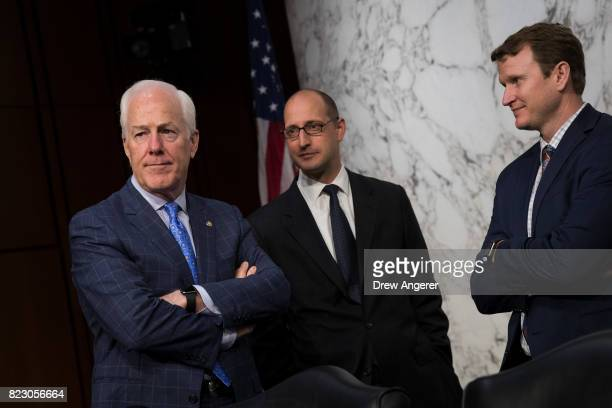 Sen John Cornyn talks with aides before the start of a Senate Judiciary Committee hearing titled 'Oversight of the Foreign Agents Registration Act...