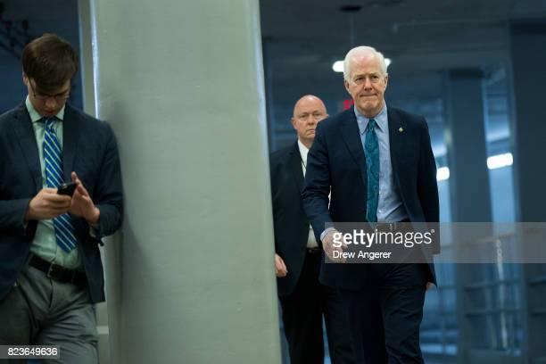 Sen John Cornyn walks through the Senate subway on his way to an amendment vote on the GOP heath care legislation on Capitol Hill July 27 2017 in...