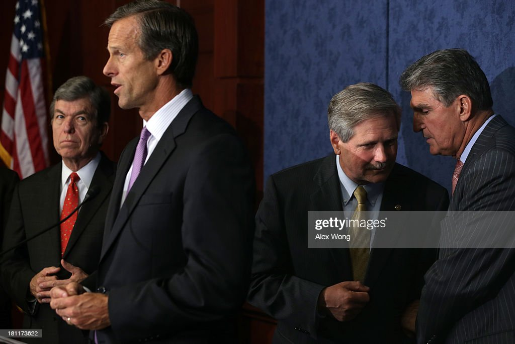 U.S. Sen. <a gi-track='captionPersonalityLinkClicked' href=/galleries/search?phrase=John+Hoeven&family=editorial&specificpeople=3082698 ng-click='$event.stopPropagation()'>John Hoeven</a> (R-ND) (3rd L) listens to Sen. <a gi-track='captionPersonalityLinkClicked' href=/galleries/search?phrase=Joe+Manchin&family=editorial&specificpeople=568465 ng-click='$event.stopPropagation()'>Joe Manchin</a> (D-WV) (R) during a news conference as Sen. <a gi-track='captionPersonalityLinkClicked' href=/galleries/search?phrase=John+Thune&family=editorial&specificpeople=534356 ng-click='$event.stopPropagation()'>John Thune</a> (R-SD) (2nd L) speaks and Sen. <a gi-track='captionPersonalityLinkClicked' href=/galleries/search?phrase=Roy+Blunt&family=editorial&specificpeople=233679 ng-click='$event.stopPropagation()'>Roy Blunt</a> (R-MO) (L) looks on September 19, 2013 on Capitol Hill in Washington, DC. The news conference was to called on the Obama Administration approve the Keystone XL pipeline project.