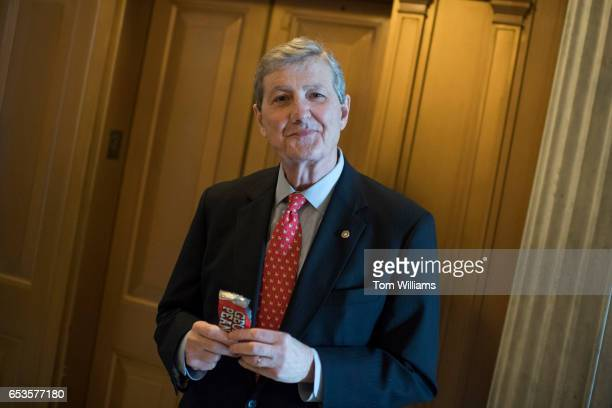 Sen John Kennedy RLa eats a bag of Georgia peanuts in the Capitol after a vote March 15 2017