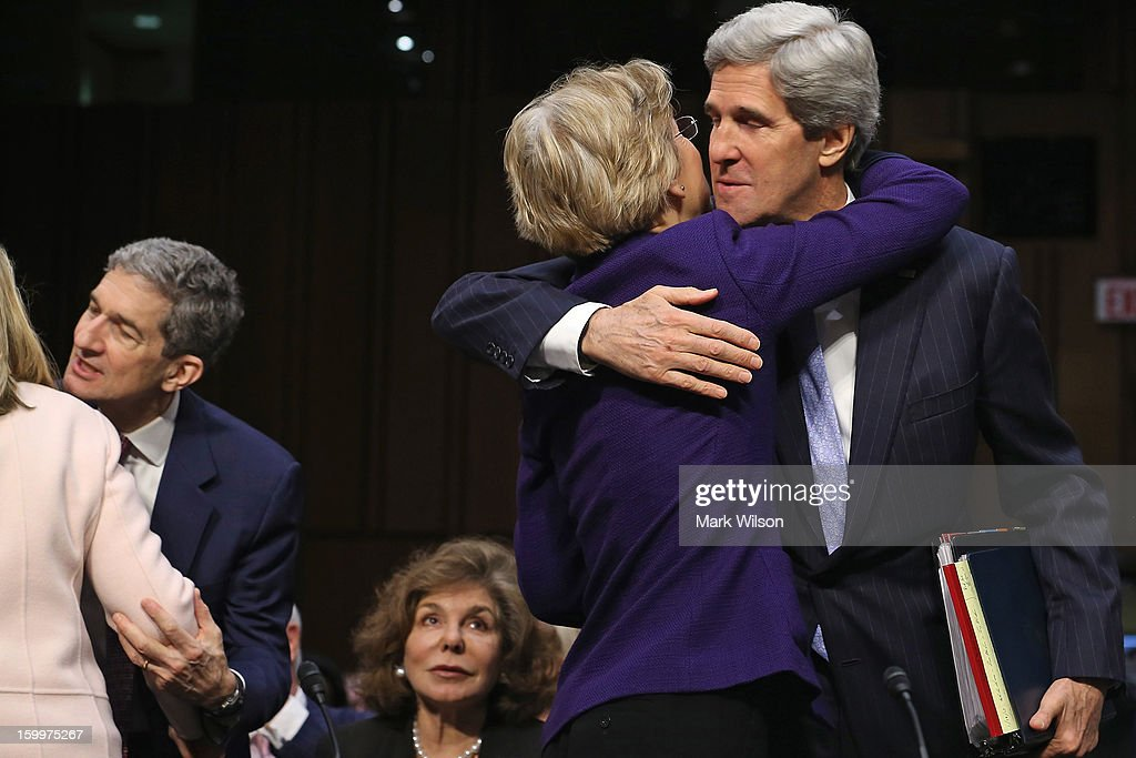Sen. John Kerry (D-MA) (R) embraces Sen. Elizabeth Warren (D-MA) after she introduced him during his confirmation hearing before the Senate Foreign Relations Committee to become the next Secretary of State in the Hart Senate Office Building on Capitol Hill January 24, 2013 in Washington, DC. Nominated by President Barack Obama to succeed Hillary Clinton as Secretary of State, Kerry has served on this committee for 28 years and has been chairman for four of those years.