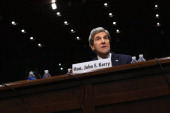Sen John Kerry gives an opening statement during his confirmation hearing before the Senate Foreign Relations Committee to become the next Secretary...