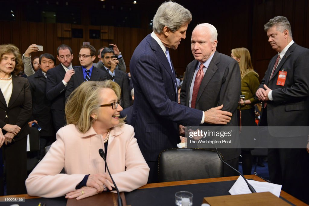 Sen. John Kerry (D-MA) greets colleague Sen. John McCain (R-AZ) and Sec. of State Hillary Clinton during Kerry's confirmation hearing as Secretary of State before the Senate Foreign Relations Committee in Washington, DC on January 24, 2013. Kerry, who served on the committee, is expected to breeze through the confirmation process.