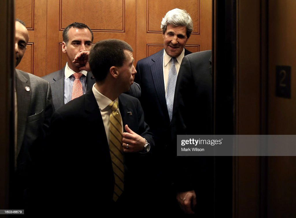 U.S. Sen. John Kerry (D-MA) (R) is surrounded by security officers as he leaves from the Senate floor in a elevator after the full Senate voted on him to become Secretary of State, on January 29, 2013 on Capitol Hill in Washington DC. The Senate confirmed Kerry to be Secretary of State with a 94 to 3 vote.