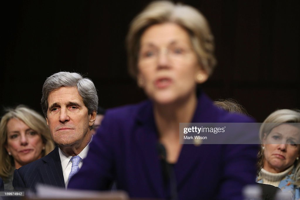 Sen. John Kerry (D-MA) (L) listens to Sen. Elizabeth Warren (D-MA) introduce him during his confirmation hearing before the Senate Foreign Relations Committee to become the next Secretary of State in the Hart Senate Office Building on Capitol Hill January 24, 2013 in Washington, DC. Nominated by President Barack Obama to succeed Hillary Clinton as Secretary of State, Kerry has served on this committee for 28 years and has been chairman for four of those years.