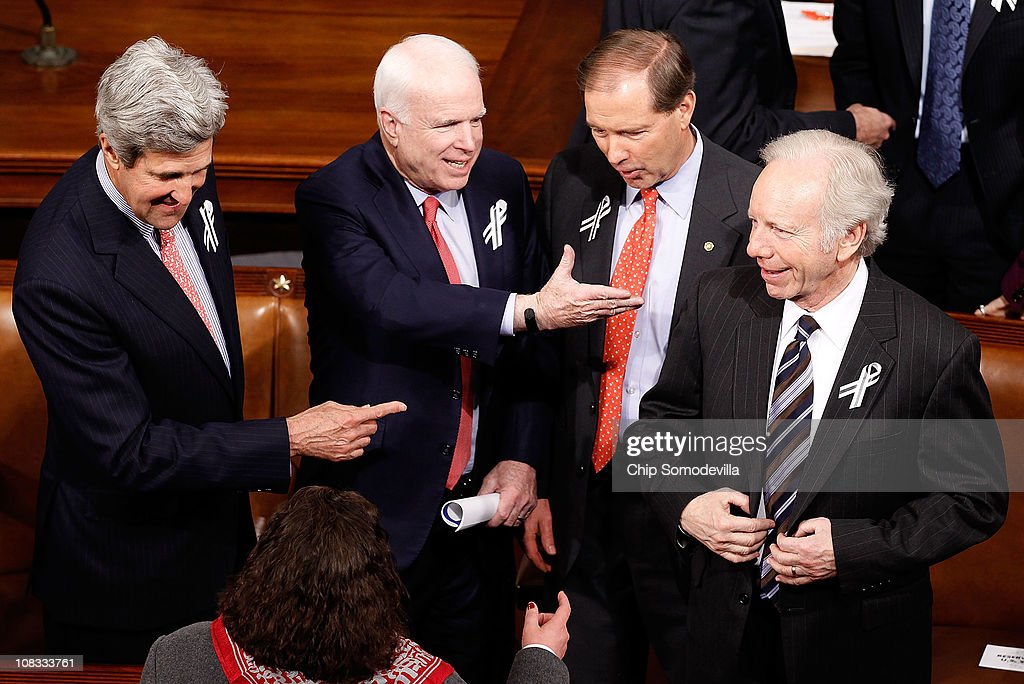 Sen. John Kerry (D-MA), Sen. John McCain (R-AZ), Sen. Mark Udall (D-CO) and Sen. Joe Lieberman (I-CT) talk before U.S. President Barack Obama's State of the Union address on Capitol Hill on January 25, 2011 in Washington, DC. Sen. Mark Udall (D-CO) first proposed bipartisan seating arrangements to foster a more cooperative spirit among lawmakers.