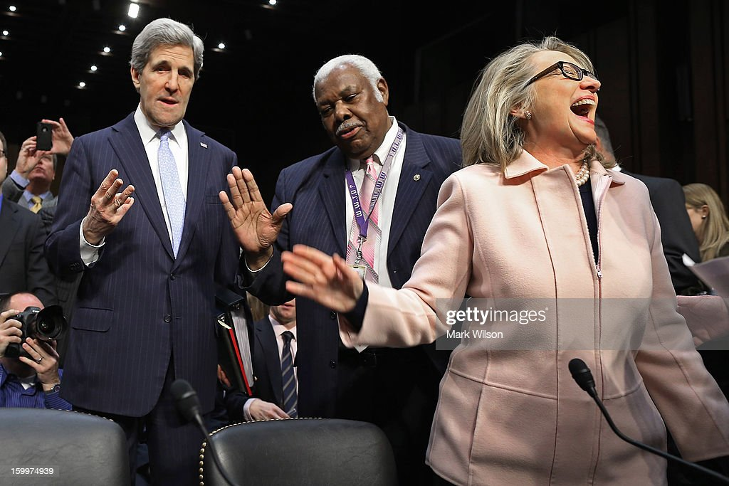 Sen. <a gi-track='captionPersonalityLinkClicked' href=/galleries/search?phrase=John+Kerry&family=editorial&specificpeople=154885 ng-click='$event.stopPropagation()'>John Kerry</a> (D-MA) talks with committee staffer Bertie Bowman as U.S. Secretary of State <a gi-track='captionPersonalityLinkClicked' href=/galleries/search?phrase=Hillary+Clinton&family=editorial&specificpeople=76480 ng-click='$event.stopPropagation()'>Hillary Clinton</a> has a laugh before Kerry's confirmation hearing before the Senate Foreign Relations Committee to become the next Secretary of State in the Hart Senate Office Building on Capitol Hill January 24, 2013 in Washington, DC. Nominated by President Barack Obama to succeed <a gi-track='captionPersonalityLinkClicked' href=/galleries/search?phrase=Hillary+Clinton&family=editorial&specificpeople=76480 ng-click='$event.stopPropagation()'>Hillary Clinton</a> as Secretary of State, Kerry has served on this committee for 28 years and has been chairman for four of those years.