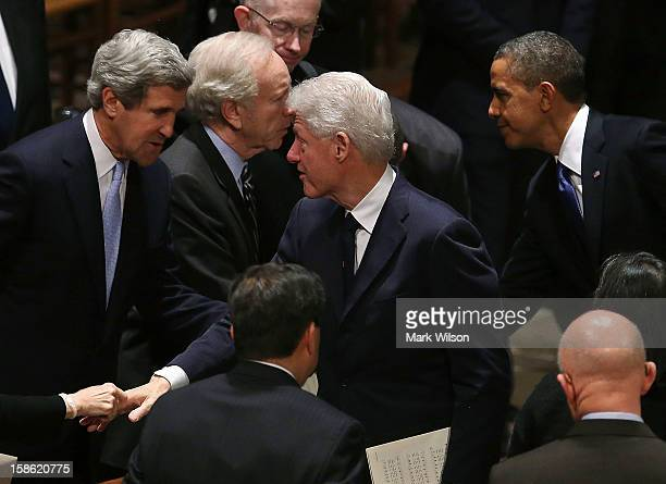 Sen John Kerry talks with former US President Bill Clinton as President Barack Obama stands nearby during the funeral service for the late Sen Daniel...