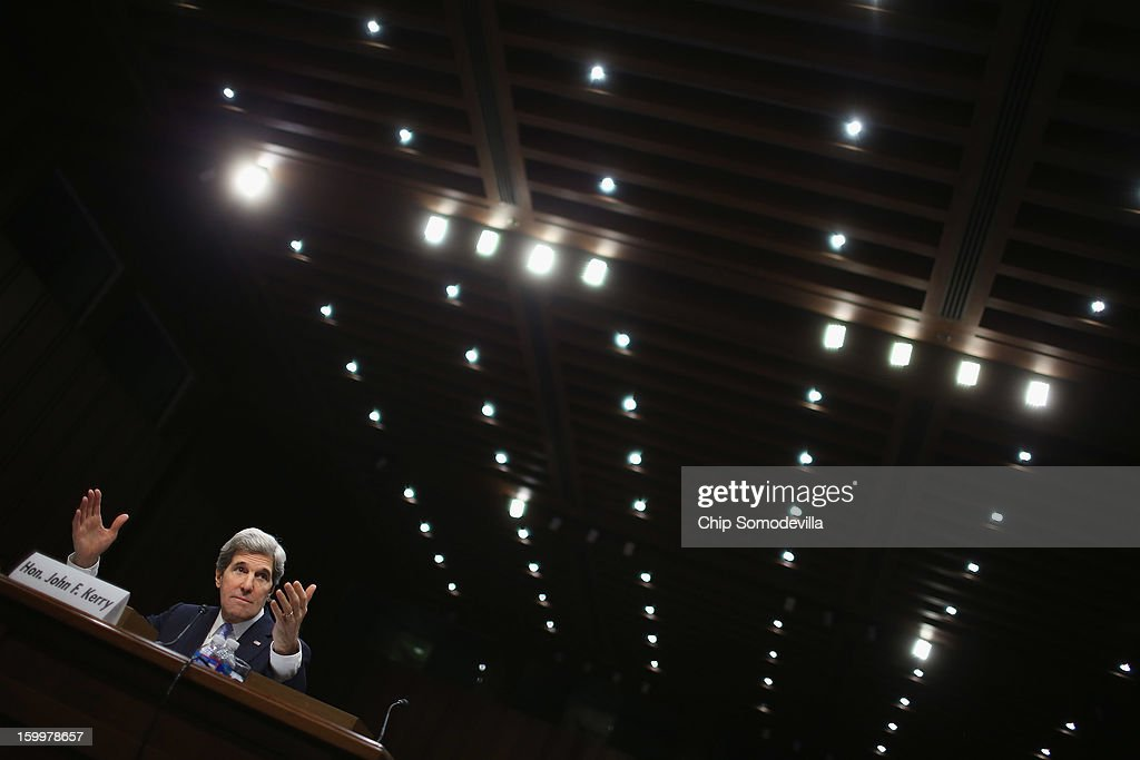 Sen. <a gi-track='captionPersonalityLinkClicked' href=/galleries/search?phrase=John+Kerry&family=editorial&specificpeople=154885 ng-click='$event.stopPropagation()'>John Kerry</a> (D-MA) testifies during his confirmation hearing before the Senate Foreign Relations Committee to become the next Secretary of State in the Hart Senate Office Building on Capitol Hill January 24, 2013 in Washington, DC. Nominated by President Barack Obama to succeed Hillary Clinton as Secretary of State, Kerry has served on this committee for 28 years and has been chairman for four of those years.