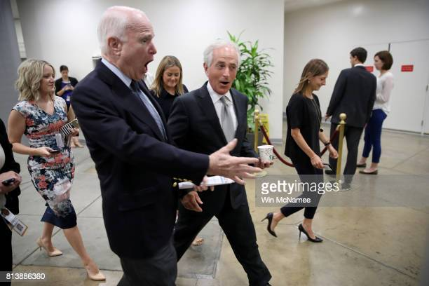 Sen John McCain and Sen Bob Corker walk to a meeting of Republican senators where a new version of their healthcare bill was scheduled to be released...