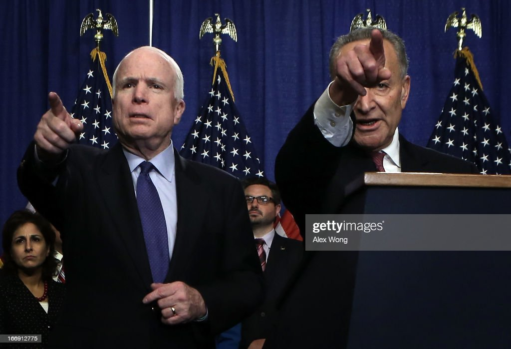 U.S. Sen. John McCain (R-AZ) (L) and Sen. Chuck Schumer (D-NY) take questions from members of the media during a news conference on immigration reform April 18, 2013 on Capitol Hill in Washington, DC. The senators discussed the 'Border Security, Economic Opportunity, and Immigration Modernization Act'.