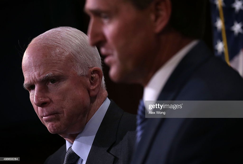 U.S. Sen. <a gi-track='captionPersonalityLinkClicked' href=/galleries/search?phrase=John+McCain&family=editorial&specificpeople=125177 ng-click='$event.stopPropagation()'>John McCain</a> (R-AZ) (L) and Sen. <a gi-track='captionPersonalityLinkClicked' href=/galleries/search?phrase=Jeff+Flake&family=editorial&specificpeople=2474871 ng-click='$event.stopPropagation()'>Jeff Flake</a> (R-AZ) (R) speak to members of the media during a news conference November 4, 2015 on Capitol Hill in Washington, DC. The senators held the news conference to release and discuss a new government oversight report 'detailing widespread evidence of the Department of Defense paying professional sports teams and leagues such as the NFL, MLB and NHL to honor American soldiers at sporting events.'