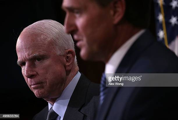 S Sen John McCain and Sen Jeff Flake speak to members of the media during a news conference November 4 2015 on Capitol Hill in Washington DC The...