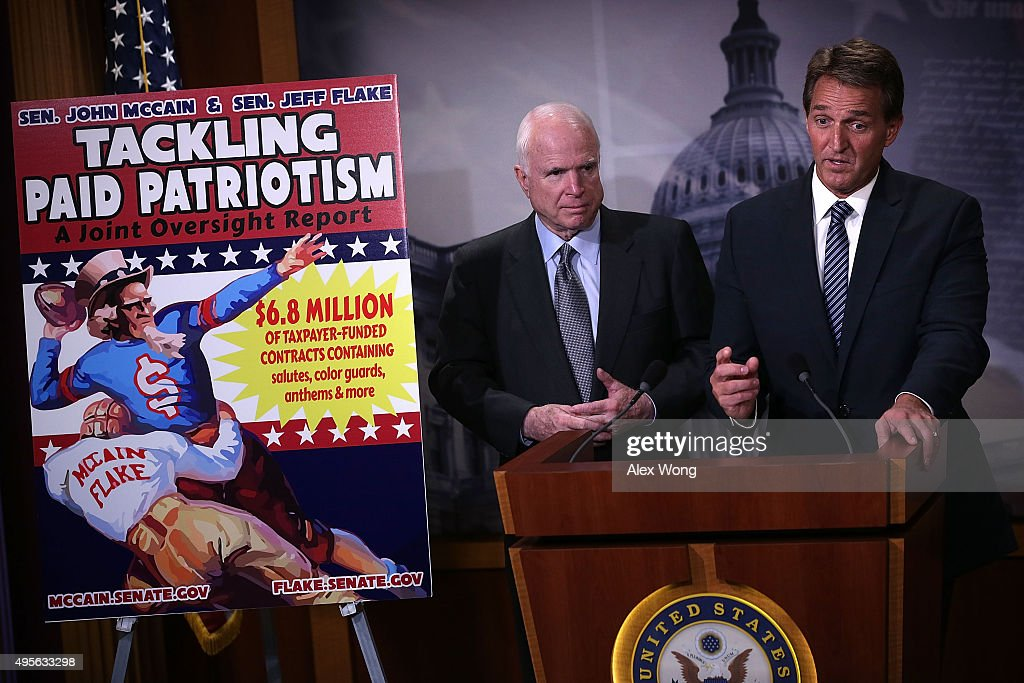 U.S. Sen. John McCain (R-AZ) (L) and Sen. Jeff Flake (R-AZ) (R) speak to members of the media during a news conference November 4, 2015 on Capitol Hill in Washington, DC. The senators held the news conference to release and discuss a new government oversight report 'detailing widespread evidence of the Department of Defense paying professional sports teams and leagues such as the NFL, MLB and NHL to honor American soldiers at sporting events.'