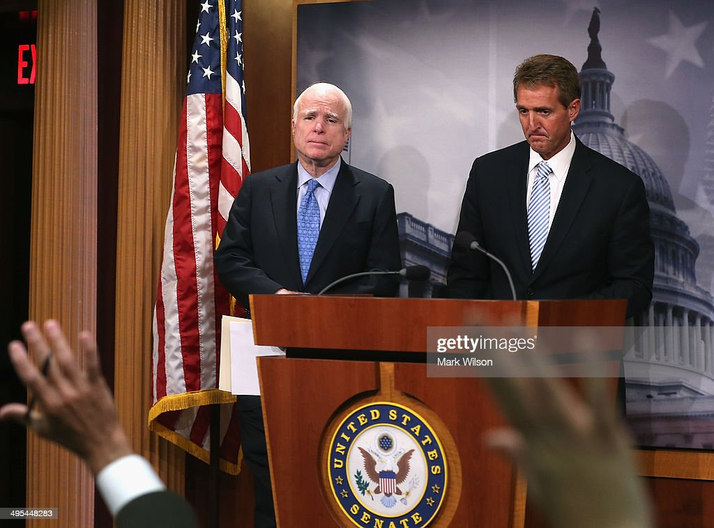 Sen. <a gi-track='captionPersonalityLinkClicked' href=/galleries/search?phrase=John+McCain&family=editorial&specificpeople=125177 ng-click='$event.stopPropagation()'>John McCain</a> (R-AZ)(L) and Sen. <a gi-track='captionPersonalityLinkClicked' href=/galleries/search?phrase=Jeff+Flake&family=editorial&specificpeople=2474871 ng-click='$event.stopPropagation()'>Jeff Flake</a> (R-AZ) take questions during a news conference on veterans affairs on Capitol Hill, June 3, 2014 in Washington, DC. Four Senators introduced The Veterans Choice Act, which addresses issues raised by the scandal at the U.S. Department of Veterans Affairs, and provides veterans with greater flexibility and choice in health care providers and increasing accountability and transparency at the Veterans Affairs administration.