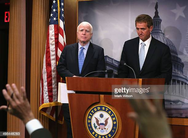 Sen John McCain and Sen Jeff Flake take questions during a news conference on veterans affairs on Capitol Hill June 3 2014 in Washington DC Four...