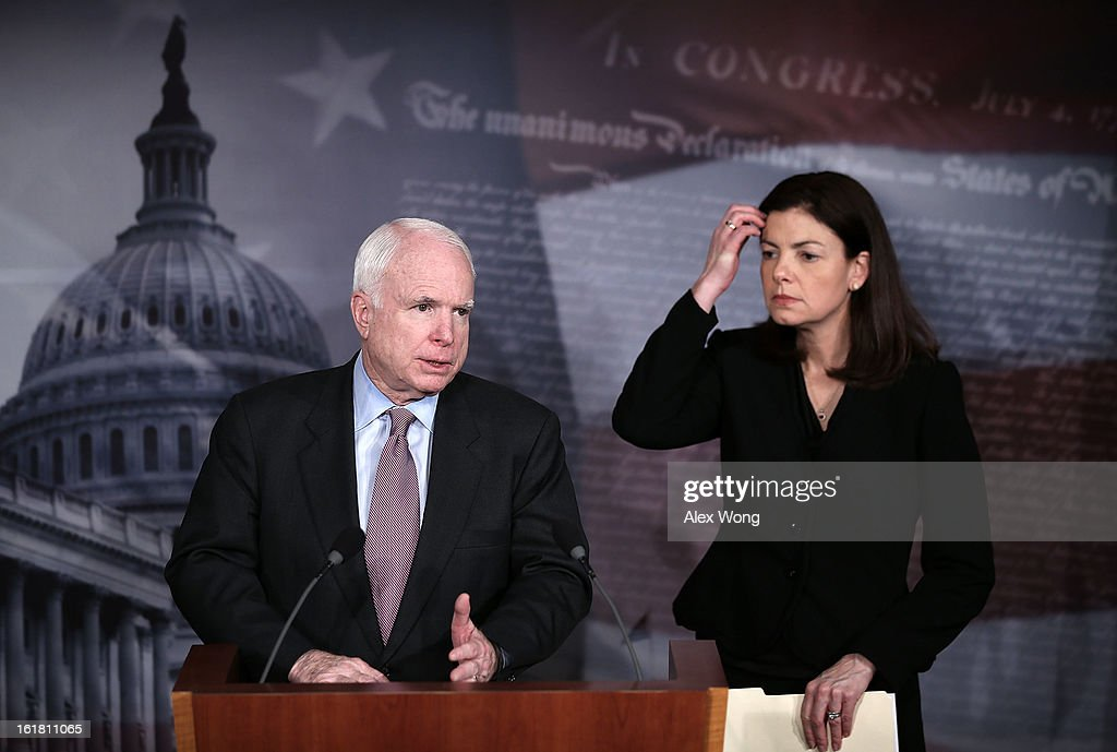 U.S. Sen. <a gi-track='captionPersonalityLinkClicked' href=/galleries/search?phrase=John+McCain&family=editorial&specificpeople=125177 ng-click='$event.stopPropagation()'>John McCain</a> (R-AZ) (L) and Sen. <a gi-track='captionPersonalityLinkClicked' href=/galleries/search?phrase=Kelly+Ayotte&family=editorial&specificpeople=6986995 ng-click='$event.stopPropagation()'>Kelly Ayotte</a> (R-NH) (R) speak to the press during a news conference on the terror attack that killed four Americans in Benghazi February 14, 2013 on Capitol Hill in Washington, DC. The senators questioned why the Obama Administration did not seek enough help from the Libya government during the attack.